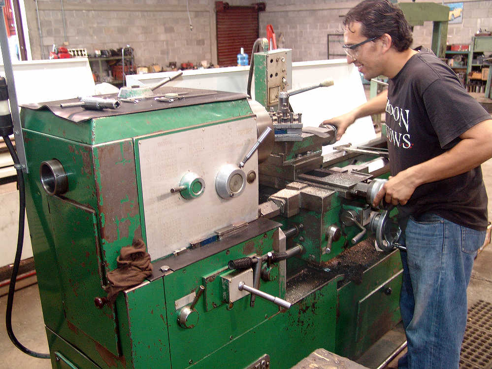 Man runs Lathe